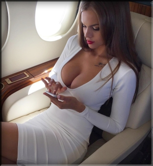 sexy hot cleavage big boob tit tits chick brunette tattoo phone huge perfect private jet plane 1st class pouting lips fuck skinny white dress girl cell facebook social media